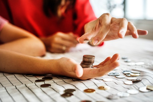 Business woman counting change